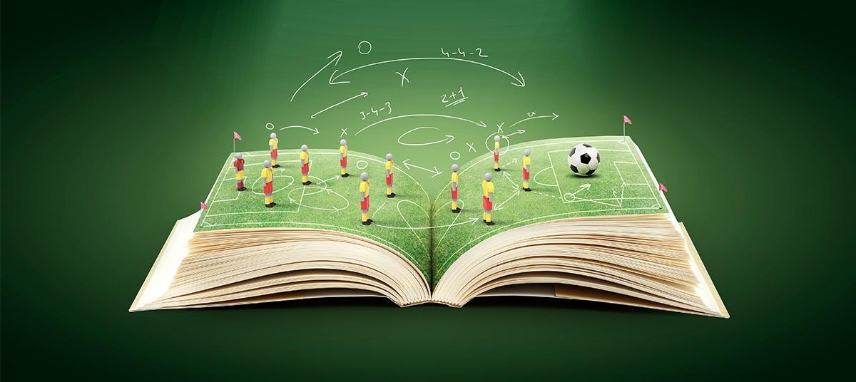 libro abierto y en la parte superior un campo de fútbol con técnicas